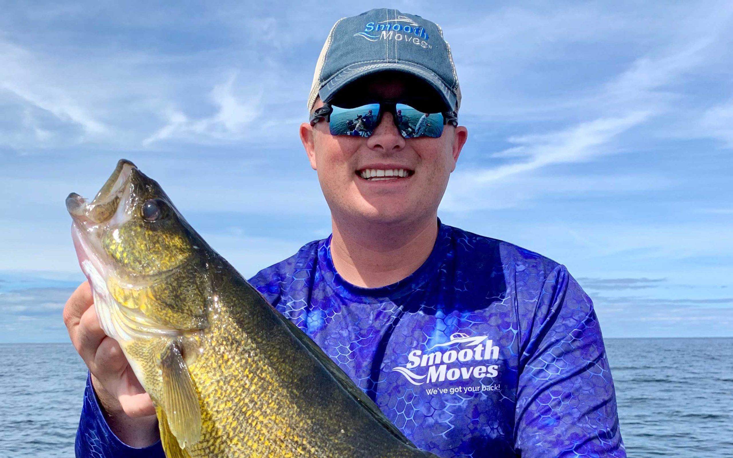 Pro angler Seth Lubber holding prize catch of the day.
