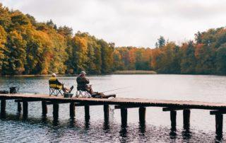Two men fishing in the fall.